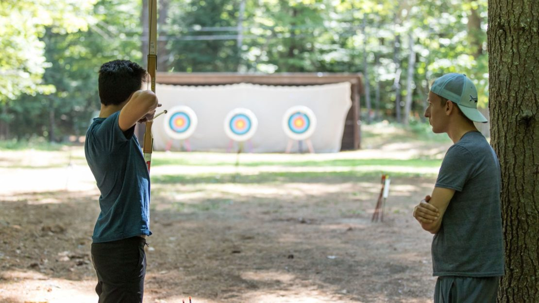 Brookwood boy and staff shooting archery arrows