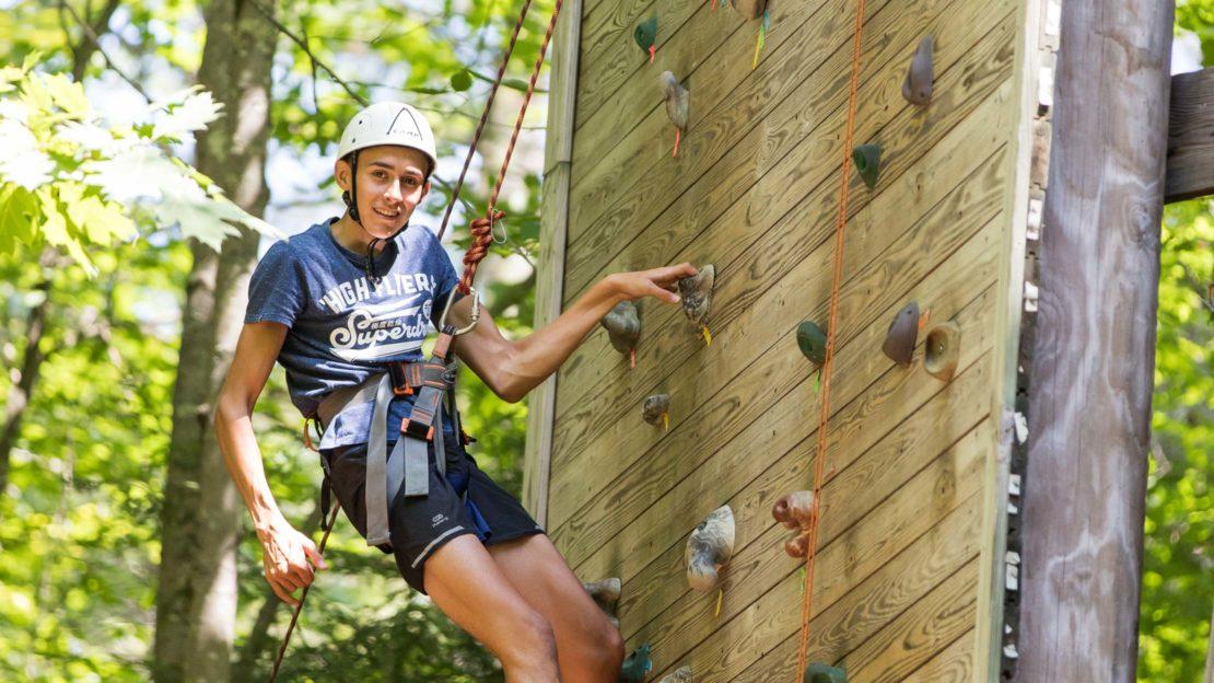 Brookwood boy rock climbing