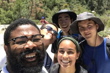 Four hikers smiling on the Leadership Development Program