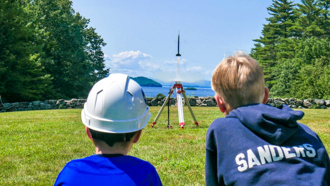 Two Brookwoods boys watching their rocket launch