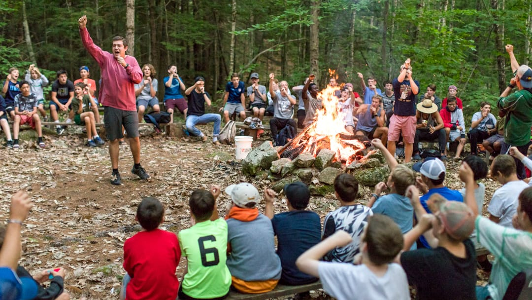 Staff leading the camp circle fire