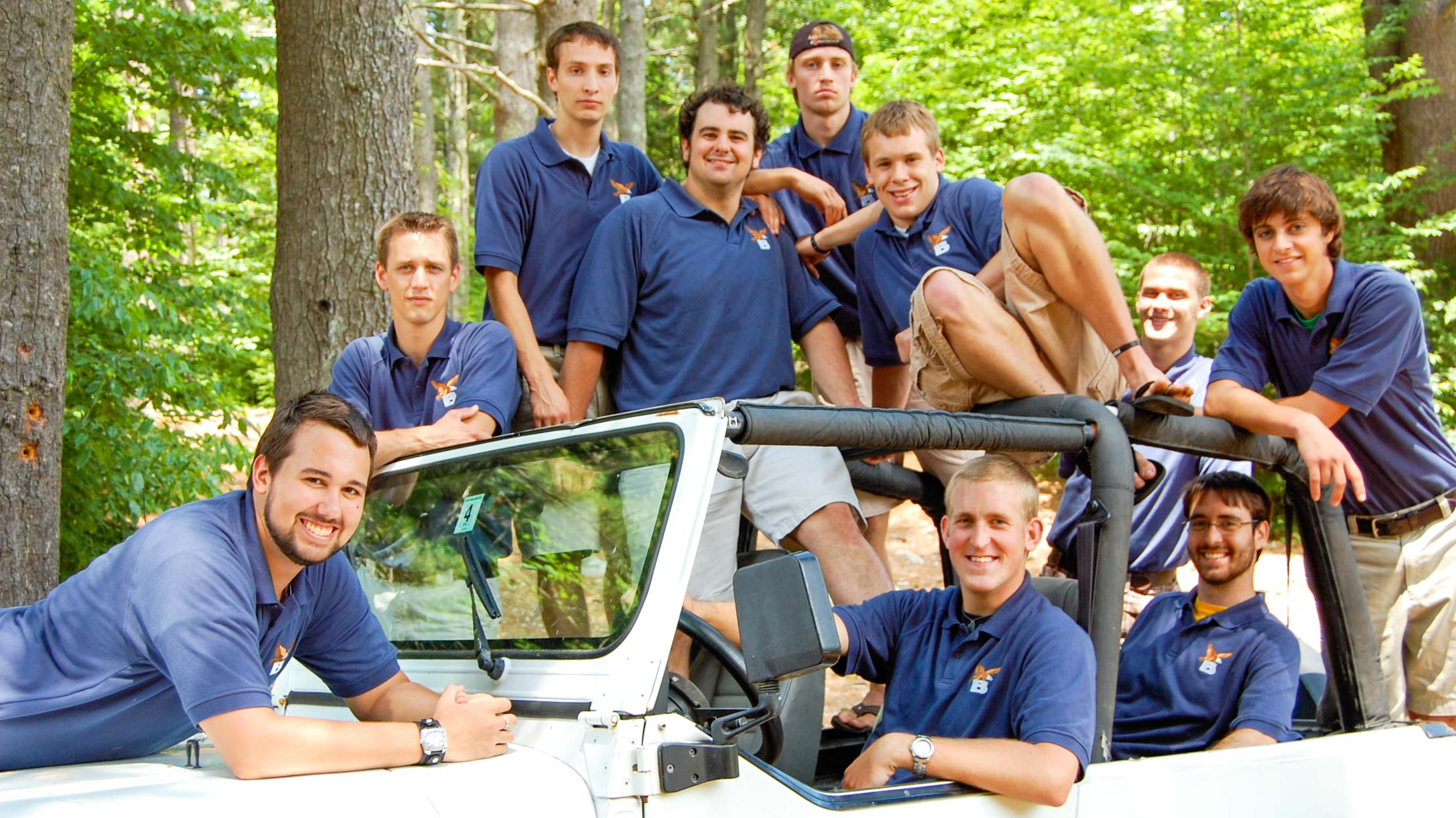 Brookwooods staff sitting on jeep