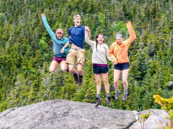 Teens jumping on a mountain on the Leadership Development Programs