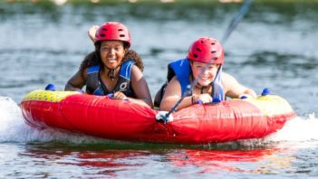 Two girls water tubing
