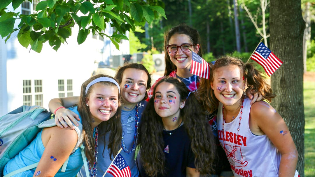 Staff and campers with flags for the 4th of July