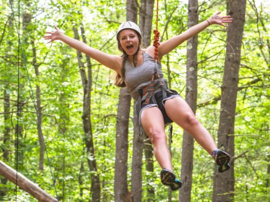 Camper on the ropes course during basic camp