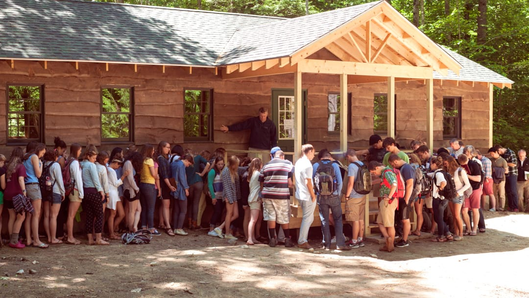 Campers lining up outside of cabin for prayer