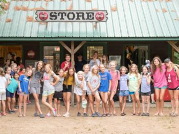 Campers standing by camp store