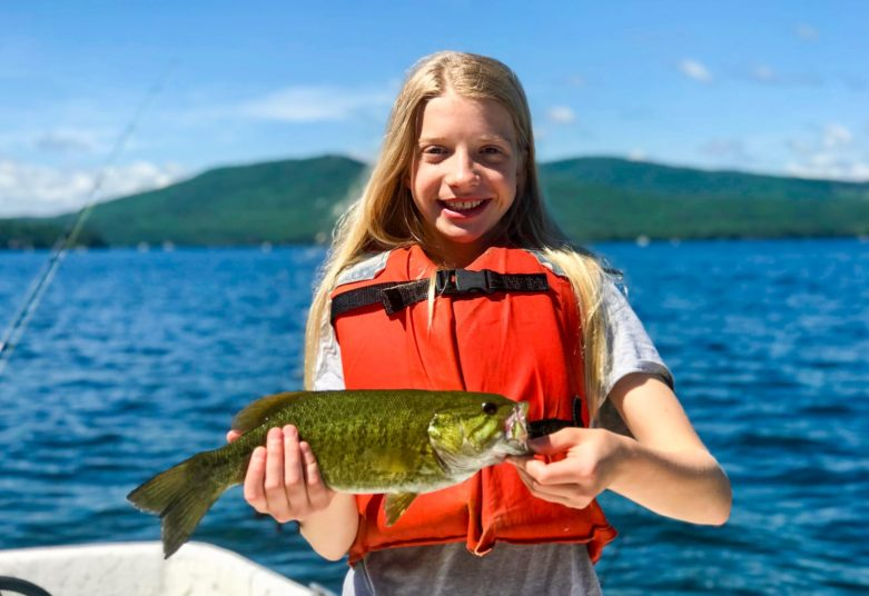 Girl with large fish she caught