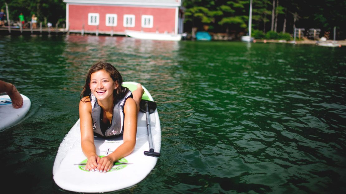 Girl on stand up paddle board