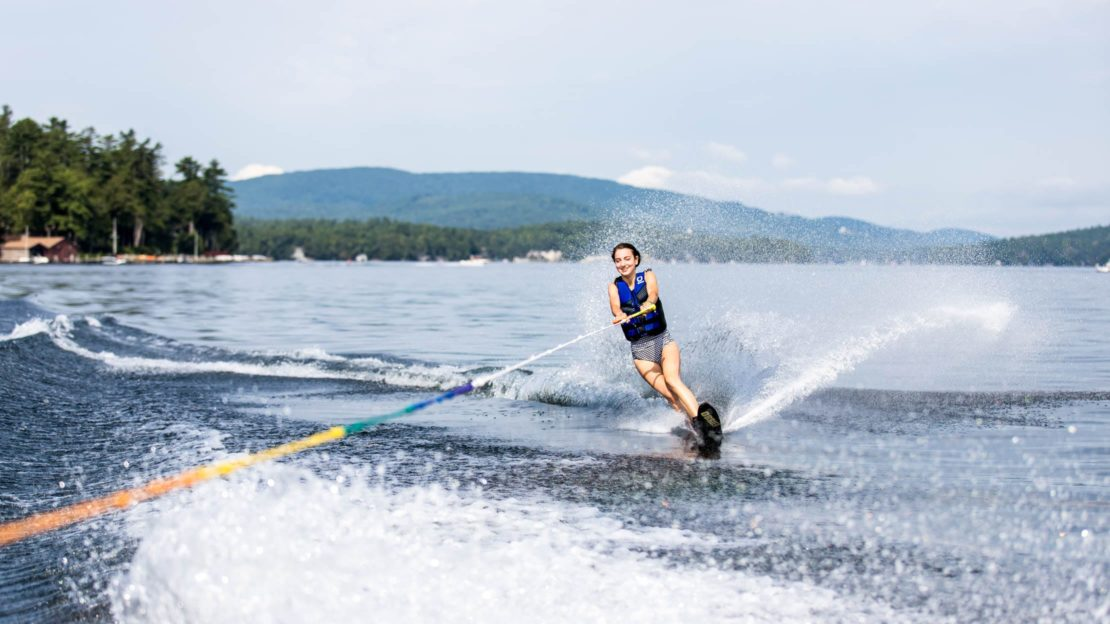 Girl wakeboarding on lake at Deer Run