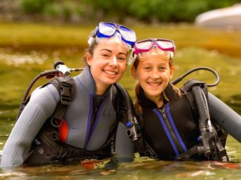 two girls wearing SCUBA gear