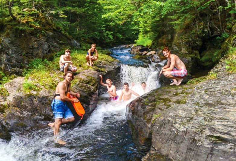 Group at a waterfall area at Moose River Outpost