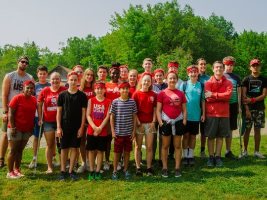 Staff and camper wearing red for a special event