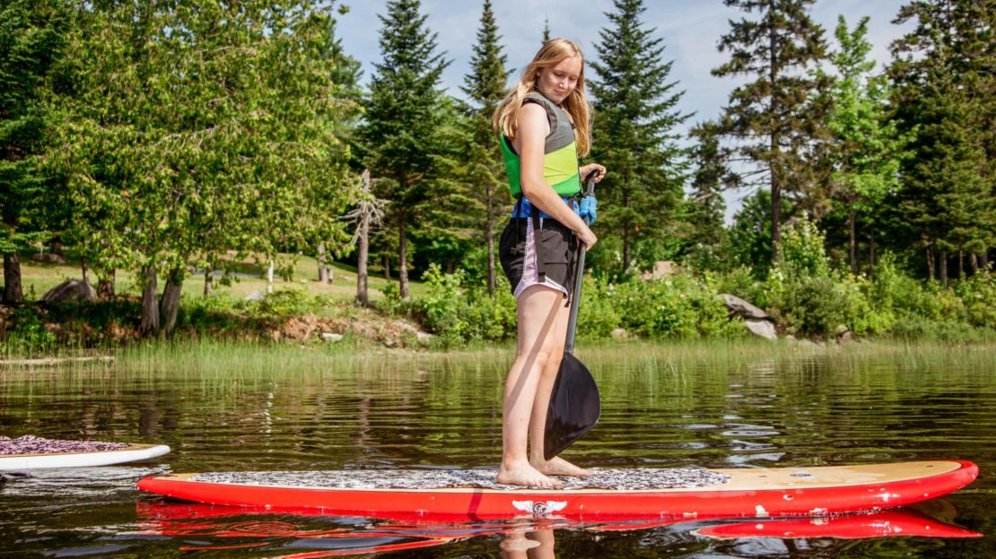 Girl on SUP board on the lake