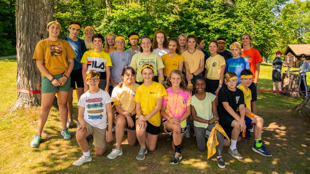 Staff and camper wearing yellow for a special event
