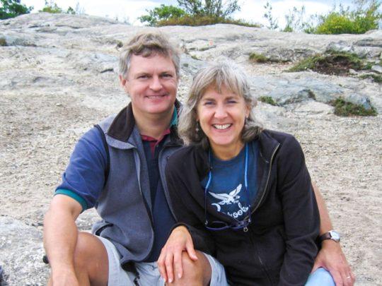 Bob Strodel and wife Debbie sitting on rocks
