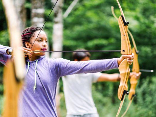 Girl shooting archery arrow