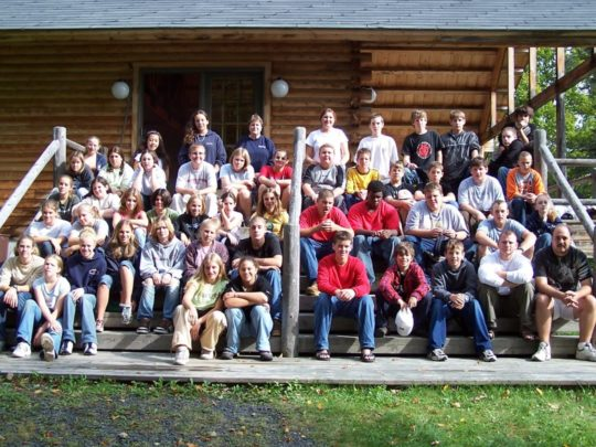 Large group sitting at the Moose River Conference Center porch