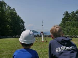 Two boys launching a rocket