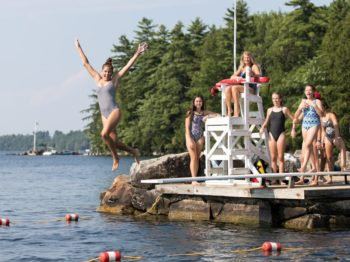 Girl jumping off a diving board