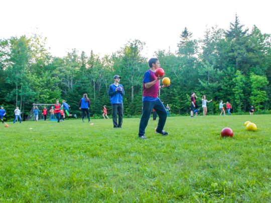 Campers playing soccer on the field